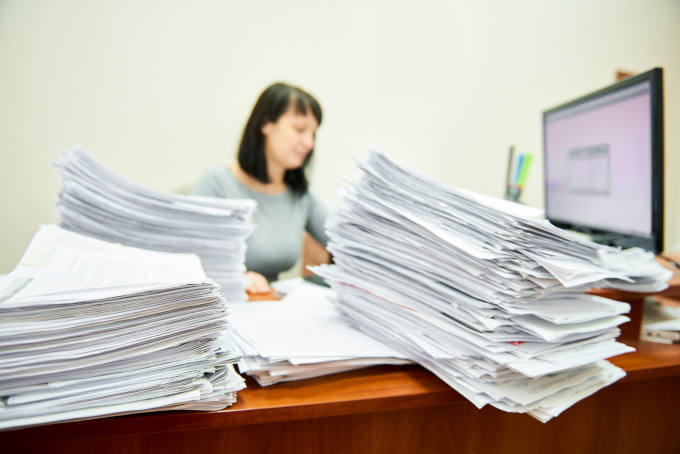 Accountant with lots of paper documents